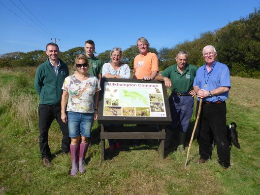 Photo of Trustees and charity Volunteers by the Kilkhampton Common Lectern